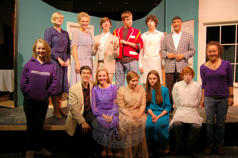 Year In Review: Newtown Middle School students performed in The Music Man March 5 through 7, with stu-dent Jeff Haylon, center, playing the lead role of Harold Hill.  (Hallabeck photo)