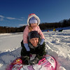 Olivia Doersch perched on her father Craig's shoulders after a fast run down the slope at Treadwell Park Monday afternoon. (Bobowick photo)