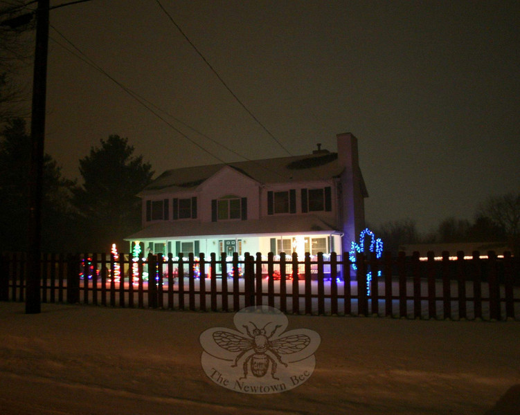 Another house decorated for the holidays. With the snow flying Sunday night, the lights had a soft focus effect.  (Hicks photo)