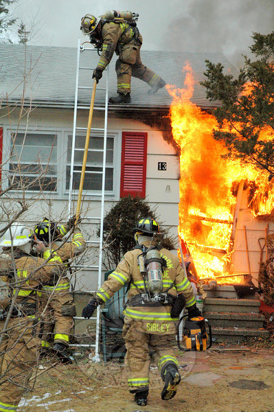 Firefighters battled an accidental blaze at a Deerfield Drive house in Sandy Hook in February, one of many events that called upon a large number of emergency personnel in 2010. Approximately 90 firefighters responded to the scene. (Bee Photo, Gorosko)