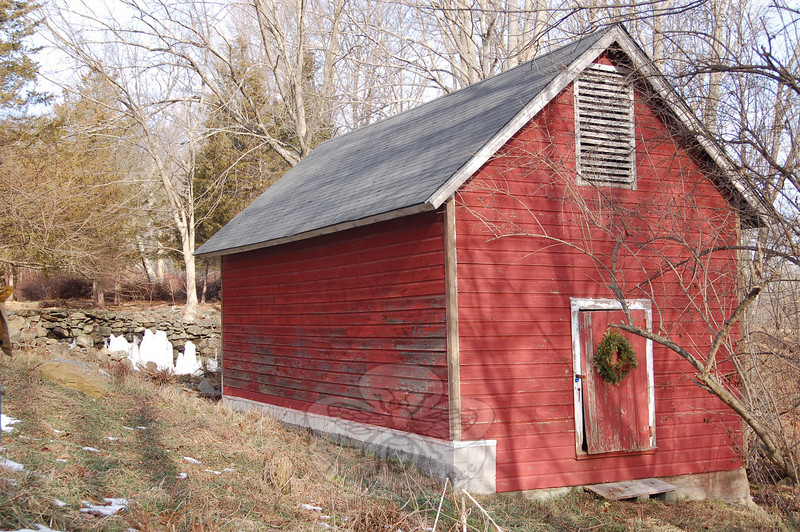This ice house on the property of Betty Lou Osborne in Sandy Hook is one of only two remaining ice house structures in town, a subject that was visited during Nancy Crevier's travels around town in 2010.  (Crevier photo)