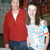 National French Day was celebrated by students studying the language at Newtown High School on Thursday, December 16, when the school's lecture hall was filled with food, posters, and music. The students participated in a T-shirt contest, where they walked around the room to display their original T-shirt designs based on France. One students from each class won the T-shirt contest. Foreign Language Department Chair Paula Greenfield stands with ninth grader Jilliane Lyon, who was one of the T-shirt contest winners.  (Hallabeck photo)