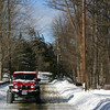 Hook & Ladder Firefighter David White used his Jeep Wrangler to block through traffic on Wendover Road on Monday, after a falling tree became ensnared in live wires. High winds topped a number of trees across town, resulting in a handful of similar road closures until damaged equipment could be repaired by CL&P crews.  (Hicks photo)