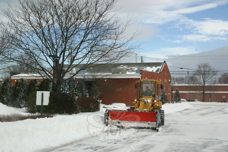 Excavators were used to remove snow from some larger parking lots.  (Hicks photo)