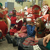 Trinity Day School preschoolers sang and wore special hats they created for a holiday con-cert held for parents on Wednesday, December 22. Some students had hats with candy canes, others had antlers like reindeer, and others decorated their hats with presents.  (Hallabeck photo)