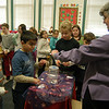 "Hawley Elementary School students cast votes on Wednesday, December 15, during a mock governor race overseen by Mary Muller from the Connecticut Historical Society's Education Department, right. After voting, each student received an ""I Voted"" sticker, like Justin Bogdanoff as seen.  (Hallabeck photo)"