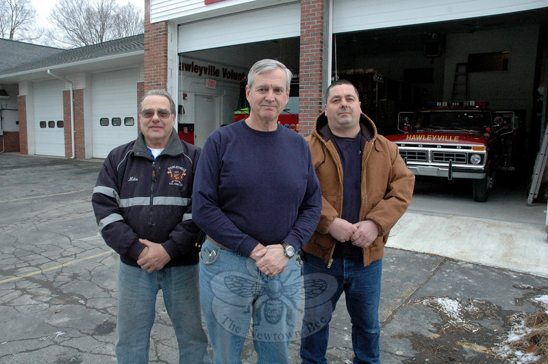 Hawleyville firefighters are planning for the future with recent modifications made to their firehouse at Hawleyville Road (Route 25). The volunteer fire company reconfigured the vehicular entrance at eastern end of its firehouse to provide added flexibility at the facility. Pictured are Chief Joe Farrell, center; Firefighter Mike Neiman, left; and Assistant Chief Dave Jossick.  (Gorosko photo)