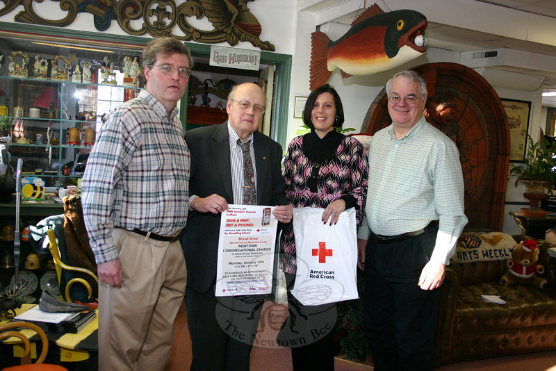 Red Cross representative Lynne Phillips, second from the right, is joined by Newtown Lions Club members, from left, Kevin Corey, Auggie D'Alessandro, and Walt Schweikert in reminding residents that an American Red Cross blood drive will be conducted on January 10 at Newtown Congregational Church. The Lions are sponsoring the event, and will provide light refreshments during the drive.  (Hicks photo)