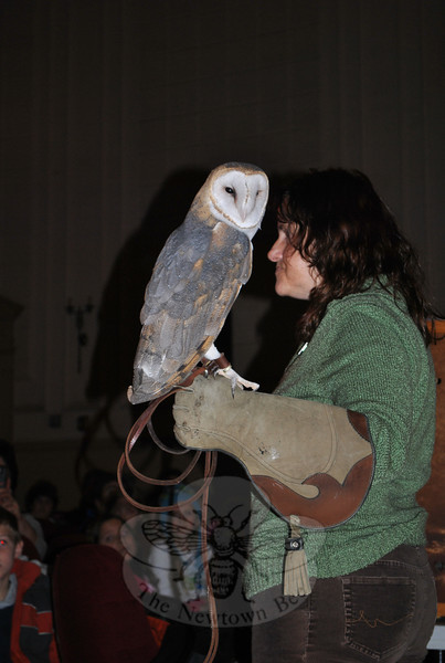Mary-Beth Kaeser holds Silo, the barn owl. The owl imprinted on people when she was born in a South Dakota wildlife center. She has been a program bird for all of her 14 years. One benefit of captivity is that she will probably live twice as long as she would in the wild.  (Crevier photo)