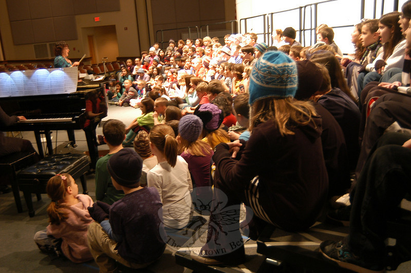 Sandy Hook School's chorus rehearsed at Newtown High School on Thursday, December 16, while Sandy Hook School music specialist Maryrose Kristopik led the group.  (Hallabeck photo)