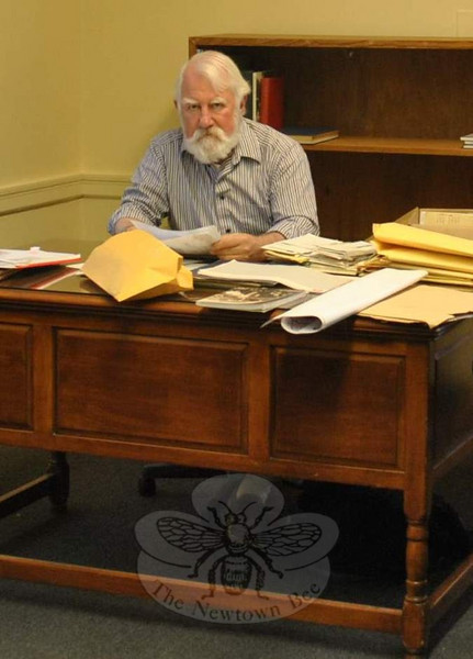 Town historian Dan Cruson, shown in his recently opened office at Edmond Town Hall, will present his annual lecture on Monday, January 10. He will be just down the street, at C.H. Booth Library.  (Crevier photo)