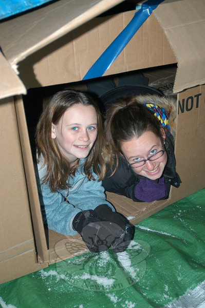 Sisters Megan and Shannon McDonald crawled inside the temporary  shelter created by NEWS members on January 8, to keep the Sleep-A-Thon participants warm throughout the night outside.  (Hallabeck photo)