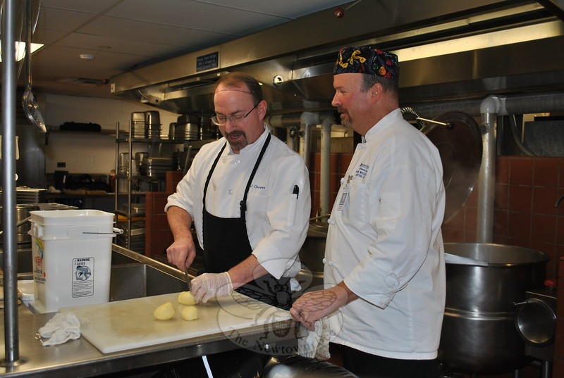 Prep Chef Paul Grewer, left, discusses the evening menu with Chef Patrick Wilson in the newly renovated Danbury Hospital kitchen, where patients' meals are now cooked to order.  (Crevier photo)