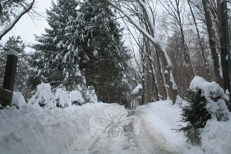 This cleared driveway on Parmalee Hill Road shows on a small scale what town crews continued to deal with a day after a winter storm dropped more than two feet of snow on Newtown. Miles of snow banks needed to be pushed back from their original locations to allow safe passage of two vehicles at a time.  (Hicks photo)