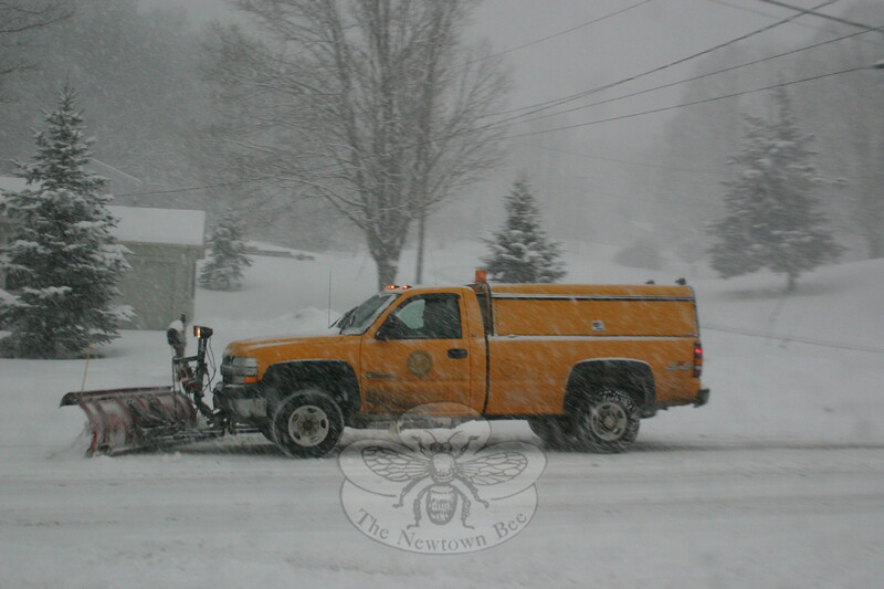A town plow travels on Riverside Road on Friday, January 7, during the second major snow storm of the 2010-11 winter season. Newtown was blanketed with at least a foot of snow before the weather event had finished.  (Hicks photo)