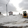 Bulldozers and excavators were used to lift snow and carry it away from roads and parking lots, such as this Caterpillar trying to clear the way at Plaza South on Wednesday.  (Bobowick photo)