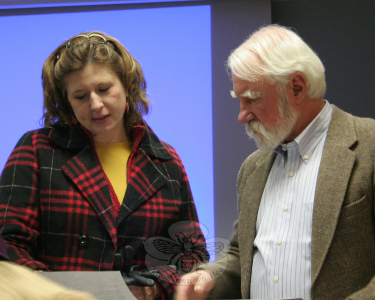 "Former Newtown Historical Society president Elin Hayes and town historian Dan Cruson discuss something prior to Mr Cruson's presentation of ""A Newtown Miscellany: What's New That's Old"" on January 10. The lecture was the annual offering by Mr Cruson.  (Hicks photo)"