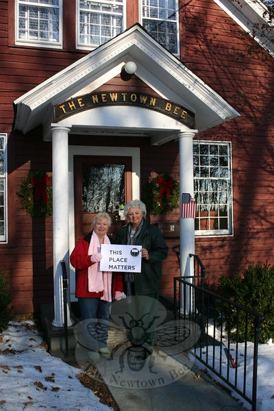 "As the new year begins, so does a new project from Newtown Woman's Club, GFWC, Inc. ""This Place Matters"" will recognize and celebrate various historic buildings throughout Newtown. Once monthly for the next few months, the club will select a building the membership feels is an important part of this town. To kick off the project the club's January selection is the home of The Newtown Bee, the town's hometown newspaper for more than 130 years. Anna Wiedemann, left, and JoAnn Bruno recently visited the familiar red building at 5 Church Hill Road, the headquarters for Bee Publishing Company, Inc, which also publishes Antiques and The Arts Weekly.  (Hicks photo)"