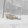 A town plow reaches intersection of Sunnyview Terrace with Riverside Road on Friday, January 7, during the second major snow storm of the 2010-11 winter season. Newtown was blanketed with at least a foot of snow before the weather event had finished.  (Hicks photo)