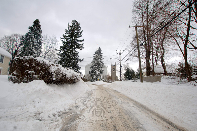 "Town historian Dan Cruson confirmed that the 27 inches of snow that fell on January 12 in Newtown is certainly ""one of the largest"" storms in town history. ""In 1922 and 1934 we had as heavy snowfall as that, so this is at least equal to that,"" he said Thursday, January 13, as town and private plows continued their efforts to clear all of the town's roads. The view from behind Newtown Meeting House on Wednesday afternoon was calm, but plows everywhere were hard at work trying to reclaim the roads.  (Bobowick photo)"