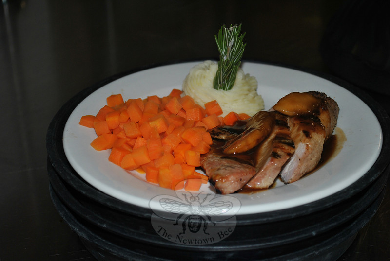 Hospital food has a new, appetizing appeal when ordered off of a personalized menu by patients at Danbury Hospital. Here, pork tenderloin with pomegranate sauce, steamed carrots, and mashed potatoes are set on a prewarmed thermal plate, ready to be delivered.  (Crevier photo)