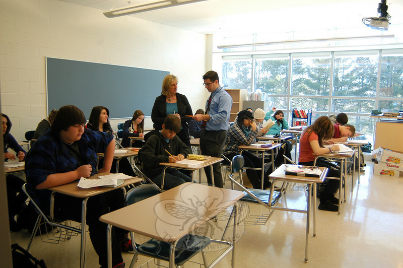 Newtown High School English teacher Jim Rovello, center right, and special education teacher Linda Sykes, center left, talk during a class in one of the new classrooms in the school's addition on Monday, January 10, the first day the new wing of the school was open for use.  (Hallabeck photo)