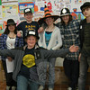 Odyssey of the Mind Team 9 members Michael Ziluck, front, and, from left in the back, Catherine Menousek, Zachary Weiland, Sydney Chiarito, Jacob Emmerthal, and Ryan Rogers stand together between working at the registration desk on Friday for this year's Spontaneous Scrimmage and heading on to solve problems in the school's cafetorium.  (Hallabeck photo)