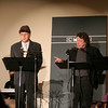 In addition to situational sketches featuring an argumentative married couple, the January 14 staged reading Radio Days: The Bickersons featured comic and advertising segments. Shown here are Don Striano, left, as a random cigarette smoker from Russia found in Central Park, and Patrick Kearney as a pitchman for The Phillip Morris Company.  (Hicks photo)