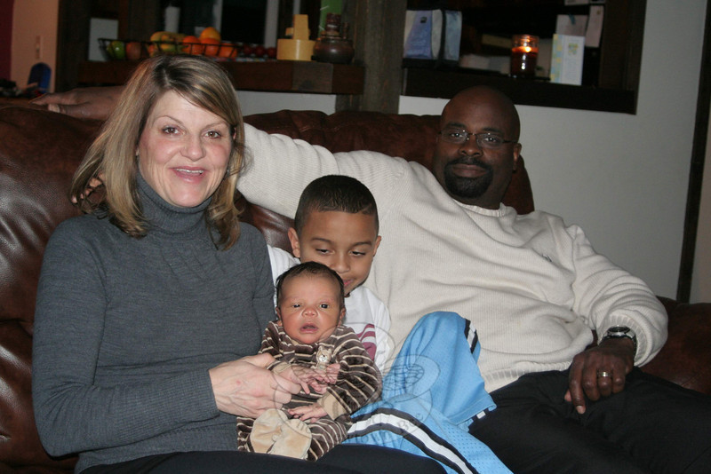 Kenneth Miller, being held by his mom, Christine, has the honor of being named The Newtown Bee's First Baby 2011. Kenneth was born on January 10, just hours before a snowstorm paralyzed the state. He and his family — which includes, from left, mom Christine, big brother Karl, and dad Konrad — have returned to their home in Sandy Hook, where they are about to be inundated with gifts and services from dozens of businesses who help sponsor the annual giveaway.  (Hicks photo)