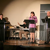 Stray Kats Theatre Company offered its second program, a staged reading of Radio Days: The Bickersons, based on radio programs adapted by Kate Katcher, on the stage of The Alexandria Room at Edmond Town Hall on January 14. Standing from left is Chilton Ryan, Jill Gureasko, Ms Katcher, and Tom Zingarelli during one of the sketches featuring Blanche and John Bickerson (Ms Katcher and Mr Zingarelli). Partially hidden at the table is sound director Jimmy DeVivo.  (Hicks photo)