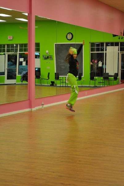 Laura Levy, one of five certified Zumba instructors at Z Place For Fitness, gets some air during a Zumba workout.  (Crevier photo)