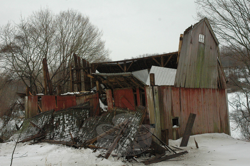 On Wednesday morning, the heavy weight of accumulated snow caused an antique barn to collapse at 3 Hedge Meadow Lane, at that street's intersection with Currituck Road. The barn is owned by Karen and Michael Sepp.  (Gorosko photo)