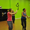 Anastasia DeMarche, left, the 17-year-old daughter of Z Place For Fitness owner Tammy DeMarche, and also a certified Zumba instructor, and friend AnnaMarie Lewis join in the fun at a class Monday, January 17.  (Crevier photo)