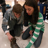 Joey Saunders, left, and Charlotte Gray, right, use a shoe to measure the midway point of a string during Odyssey of the Mind's annual Spontaneous Scrimmage on Friday, January 14.  (Hallabeck photo)