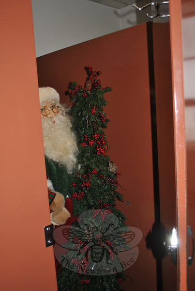 The ladies of The Bee were quite startled Wednesday to find a life-sized Santa Claus in one of the restroom stalls. The unexpected visitor elicited one or two squeals that were heard up and down the hall. No one is owning up to the bit of mischief…  (Crevier photo)