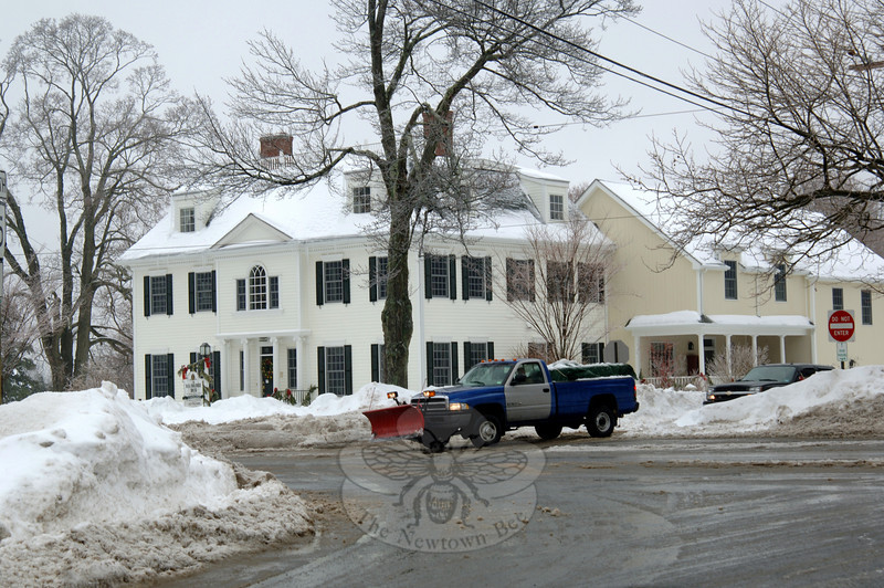 The Dana-Holcombe House on Main Street is surrounded by mounds of snow pushed to the roadside by snowplows.   (Bobowick photo)