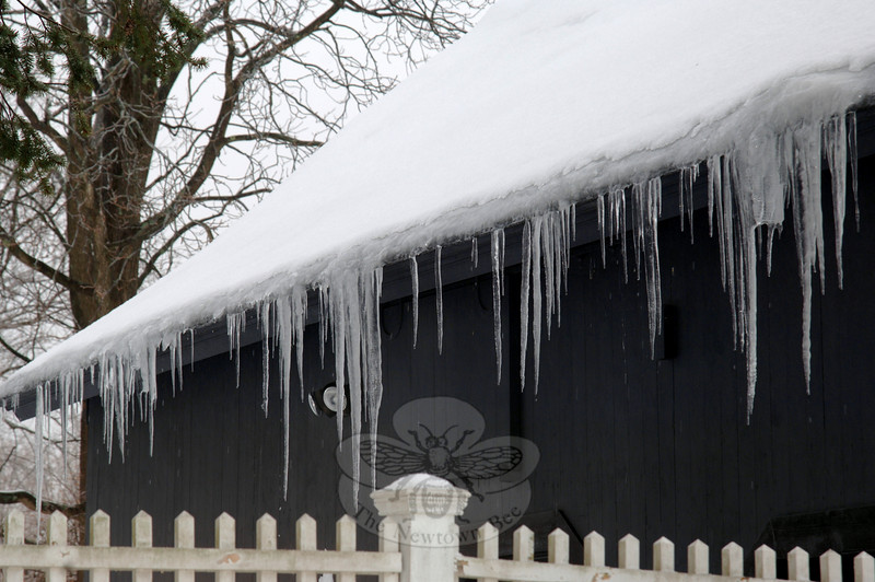 Rows of icicles line most rooftops as the snow cover melts, trickles over the edge, and reaches for the ground.  (Bobowick photo)