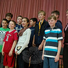 Reed Intermediate School National Geographic Geography Bee participants stand with Reed Principal Sharon Epple, left, and Reed sixth grade teacher Maura Drabik, right, after the competition named Gavin Stubbs, fourth from right, this year's champion at the school on Tuesday, January 11.  (Hallabeck photo)