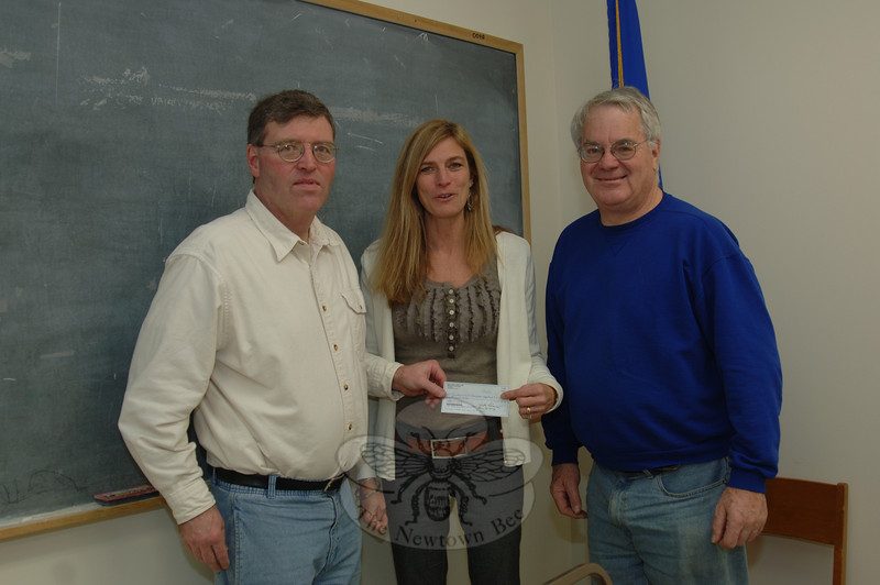 Newtown Lions Club Treasurer Kevin Corey, left, presents a $5,000 check to Praks & Recreation Department Director Amy Mangold, center. He and club President Walter Schweikert met with Ms Mangold on Friday, January 14. She plans to apply funds to trails and passive recreation activities.  (Bobowick photo)