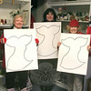 Valentine's Day is approaching and while many people will be wearing red as part of their outfits on February 14, the Newtown VNA would like to invite everyone to join the annual movement to Go Red For Women. To raise awareness about women's heart health, the local chapter is encouraging everyone to wear red on Friday, February 4. The VNA will be distributing women's heart health information throughout town to inform people about the signs of heart attacks, which can include chest discomfort, discomfort in one or both arms, the back, neck, jaw or stomach; shortness of breath (with or without chest discomfort), cold sweats, nausea and/or lightheadedness. Information will be available at the municipal center, senior center, Edmond Town Hall, Children's Adventure Center, Drug Center, Booth Library, and the Newtown VNA Thrift Shop. Meanwhile, VNA members, from left, Anna Wiedemann, Toni Catalina, and Mae Schmidle, were at the VNA Thrift Shop recently to see if they could add anything to their red ensembles. The Thrift Shop will host a special sale on Saturday, January 29, when it is open from 9 am until noon: all red clothing will be 50 percent off.  (Hicks photo)