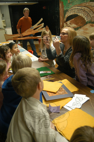 Joanne Hunter, center, co-owner of The Art Spot, a school of fine arts on Route 7 in Danbury, shows Head O' Meadow students on Monday, January 24, how to create copper leaves for a schoolwide sculpture installation.  (Hallabeck photo)
