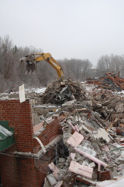 A backhoe moves rubble in a sea of debris that once was Litchfield House Wednesday afternoon. Demolition crews finished leveling the structure that day.  (Bobowick photo)