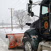 Archie Paloian maneuvered a town plow through narrow Fairfield Hills lanes, including Primrose Street in front of Newtown Municipal Center, on February 1.  (Bobowick)