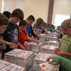 Two lines of students worked to prepare boxes of letters to be shipped for the Valentines For Troops program.   (Hallabeck photo)