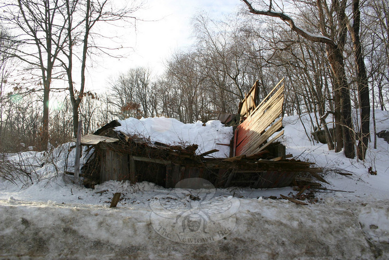 A historic barn on Peck's Lane, near its intersection with Main Street South, collapsed on January 27 due to the weight of the accumulated weight of snow on its roof. The building was vacant, and had no assessed value, according to owner Robert Hall. It was slated for demolition.  (Hicks photo)
