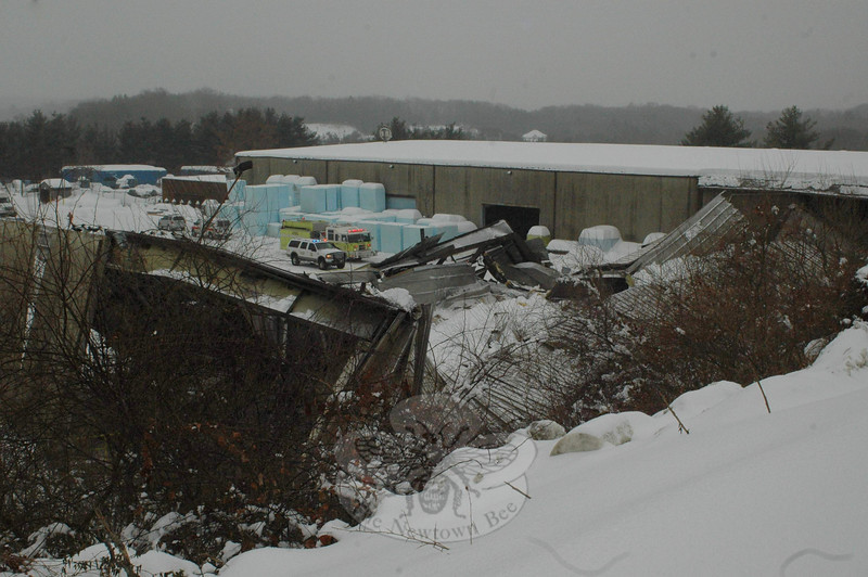 Botsford Fire Rescue personnel can be seen at the site of a partial building collapse at the BlueLinx industrial facility at the corner of South Main Street and Ethan Allen Road on February 1. While it appeared that some stored materials and at least one vehicle were damaged in the incident, no hazardous substances nor personnel were affected.  (Voket photo)