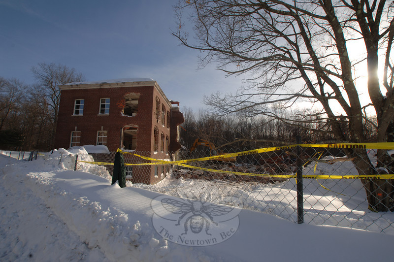 The remainder of Litchfield House, sectioned off by caution tape, was adjacent to Newtown Youth Academy before it was knocked down.  (Bobowick photo)