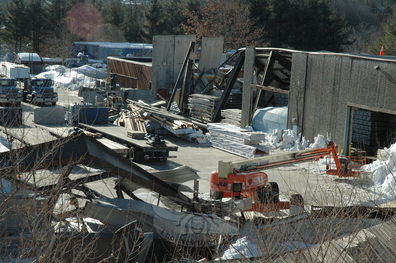Three structures have collapsed at the BlueLinx Corporation's warehousing site on South Main Street since February 1. The wreckage in the foreground is the remains of a large storage that collapsed on February 1. The warehouse in the background collapsed on February 8.  (Gorosko photo)