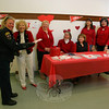 Each year the American Heart Association asks people to wear red on National Wear Red Day to raise awareness for cardiovascular disease in women. Cardiovascular disease, a largely preventable ailment, kills approximately 500,000 women each year. Newtown VNA once again supported Wear Red Day on Friday, February 4. Members of the local chapter took turns staffing a table with information for everyone who worked at and visited the Newtown Municipal Center that day. Animal Control Officer Carolee Mason, left, was on her way through the municipal center on business when she stopped to pick up a pin in the shape of a red dress and some of the available information. Working the table during the 10 o'clock hour were, from left, Mae Schmidle, Anna Wiedemann, Deb Osborne, Carol Garbarino, Jody Murphy, and Toni Catalina.  (Hicks photo)