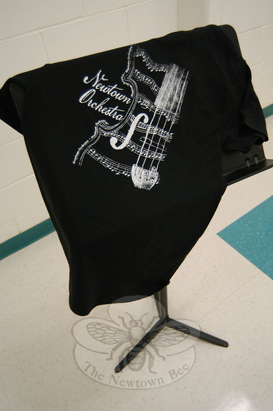 Reed Intermediate School student-designed T-shirts are now being sold at the school to raise money for the Newtown Orchestra Scholarship Fund. Anyone in Newtown can order a shirt by contacting Mardi Smith at smithm@newtown.k12.ct.us or Denise Rodrigues at rod-riguesd@newtown.k12.ct.us for order forms.  (Hallabeck photo)